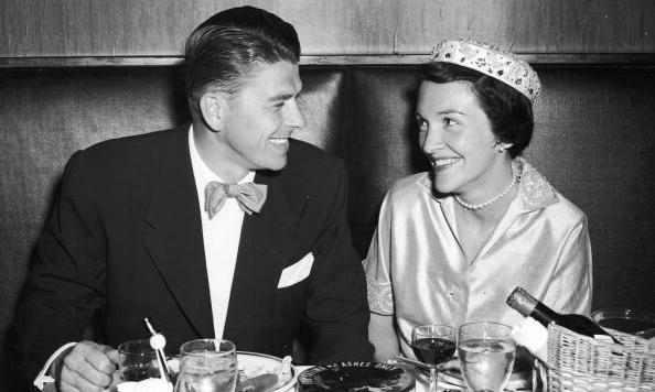 The look of love: Newlywed Nancy enjoys a honeymoon dinner with her new husband Ronnie Reagan – then a fellow silver-screen actor – at the Stork Club in New York City in 1952. 