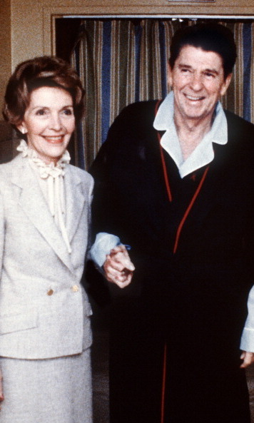 Supporting her husband through his recovery four days after he survived an assassination attempt in 1981. President Reagan had been shot by John Hinckley and was hospitalized for a total of 12 days. 