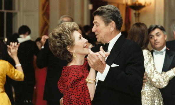 Wearing one of her signature red dresses, Nancy took to the dance floor with Ron in the White House in one of many photos of the couple doing one of the things they loved most.