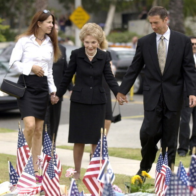 In 2004, President Reagan died at the age of 93. Here, two of her children, daughter Patti Davis and son Ron, Jr., held the former First Lady's hands before the President's burial at the Ronald Reagan Presidential Library and Museum in Simi Valley, California. 