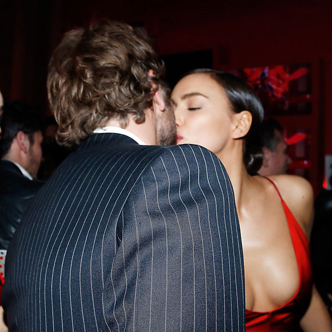 Bradley and Irina put on a public display of affection at the star-studded party.