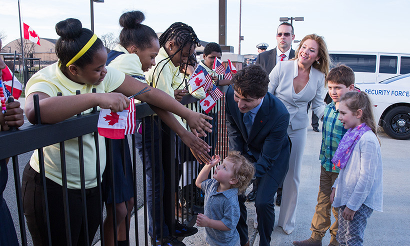 Hadrien Trudeau receives a cheerful welcome from bystanders at the airport. 