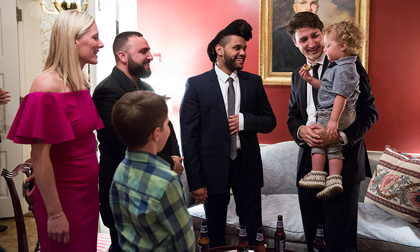 Little Hadrien charms singer The Weeknd backstage at the Canada 2020 reception. 