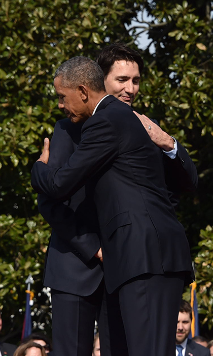President Obama greets Justin Trudeau with a friendly hug during the welcome ceremony on the South Lawn of the White House. 