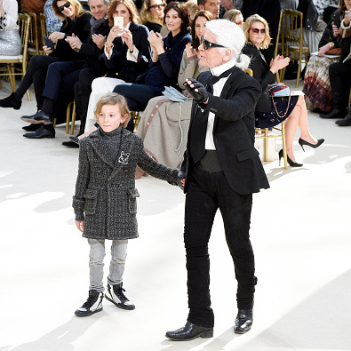 Chanel's Creative Director Karl Lagerfeld walked the runway with his godson Hudson Kroenig following the French house's womenswear fashion show.