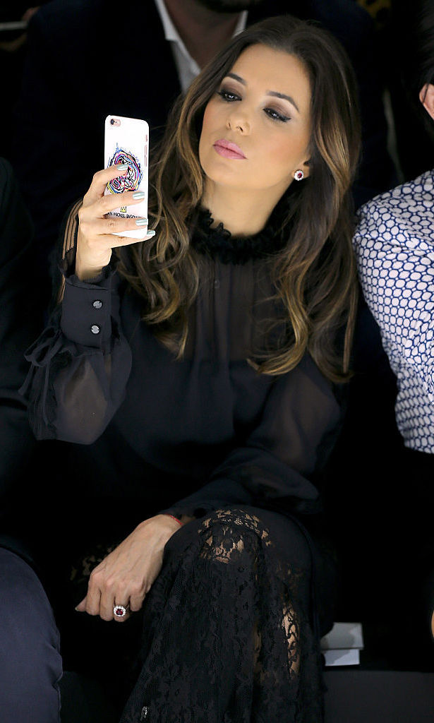 Eva Longoria sat front row at the Shiatzy Chen show, where she snapped photos of the fall/winter looks.