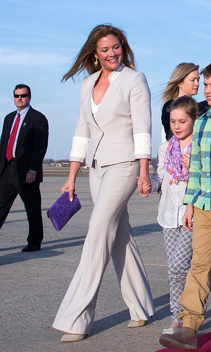 The stylish mother of three arrived in Washington in a dove-grey suit by Vietnamese-Canadian designer DUY, based in Montreal. She accessorized with fellow Canadian brands - Dean Davidson earrings, Aldo pumps and a punchy purple ELA clutch. 