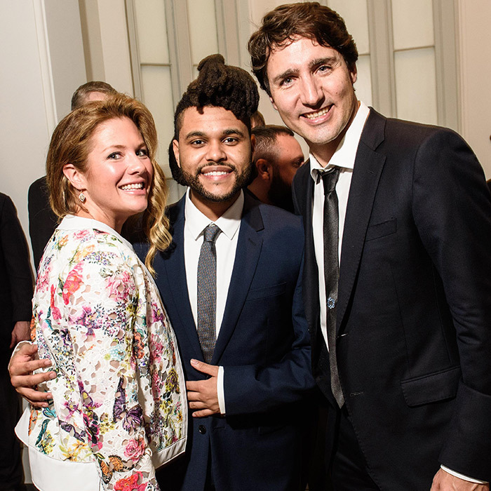 Sophie, clad in a jacket by Canadian designer Ellie Mae, The Weeknd and Justin pose backstage at the Canada 2020 gala. 