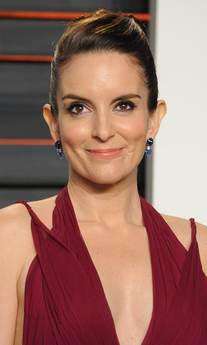 Tina Fey has plenty in common with her <i>30 Rock</i> alter-ego Liz Lemon, including their first names. The actress-writer was born Elizabeth Stamatina Fey.