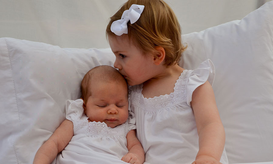 Princess Victoria captured this sweet moment between her daughter Princess Estelle and niece Princess Leonore in April 2014. Two images released by the princess showed Estelle planting a kiss on her cousin's head and holding her tiny foot.