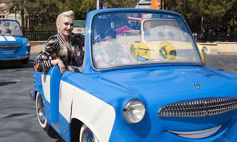 Gwen Stefani hitches a ride from her nine-year-old son Kingston at the all-new Cars Land attraction at Disney California Adventure Park. 