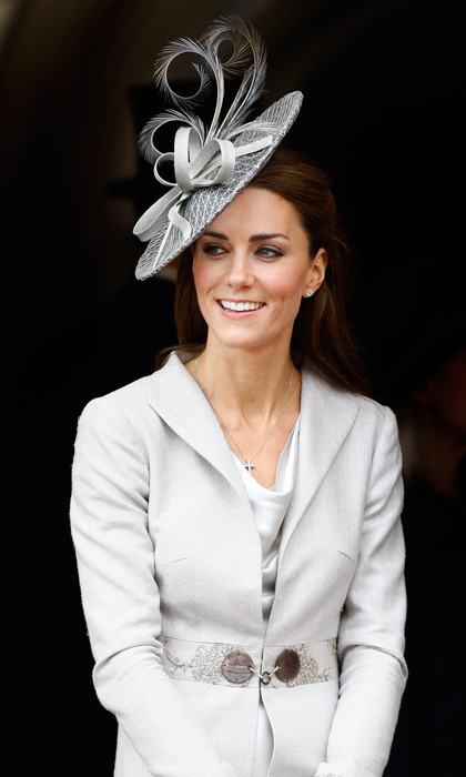 Matchy matchy! Kate coordinated her silver hat with a silver silk dress and a grey coat by Katherine Hooker for The Order of the Garter ceremony.