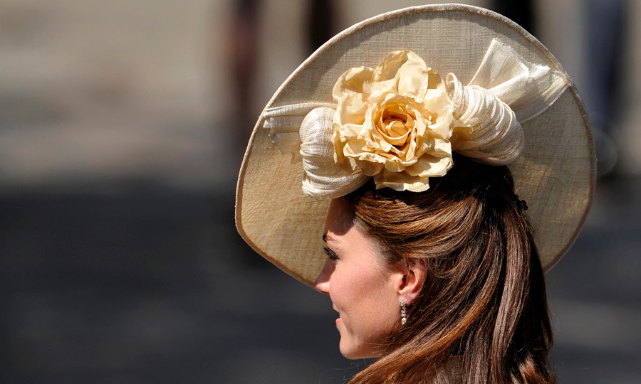 She may have recycled the outfit she wore for Zara Phillips and Mike Tindall's 2011 wedding, but Kate freshened up the ensemble by debuting an oversized headpiece designed by British milliner Gina Foster
