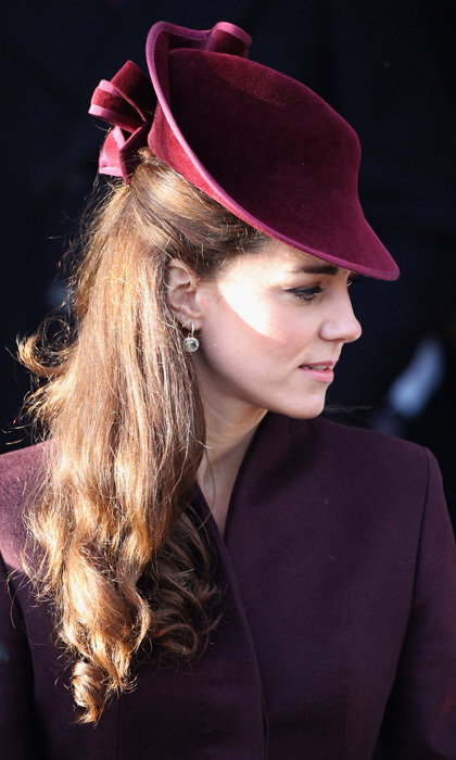 Kate's mulberry-coloured, Jane Corbett-designed headpiece stole headlines around the world after she sported the couture creation for her first official Royal Christmas Church Service in 2011.