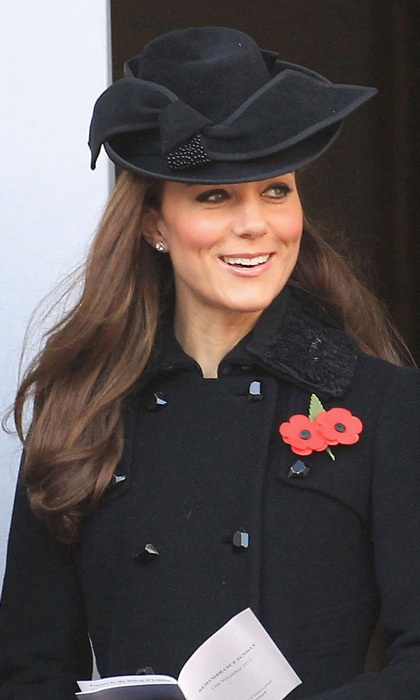 On Remembrance Day, the Duchess wore an appropriate black bowler-style hat with a swooping brim by Jane Corbett to match her Diane Von Furstenberg coat.
