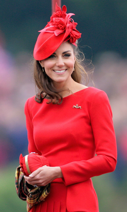 Kate was ravishing in a vivid red Sylvia Fletcher hat for the Queen's River Pageant celebration in 2012, which she paired with an Alexander McQueen dress.