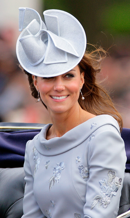 Riding about town in a horse-drawn carriage – and wearing an ice-blue Jane Corbett creation atop of her perfectly coiffed yet windswept tresses – Kate was perfectly regal at the Trooping the Colour parade in 2012.
