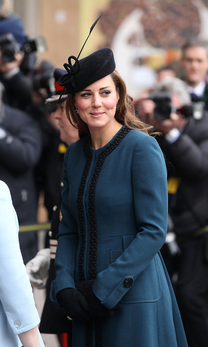 She may have been riding the subway, but pregnant Kate looked stylish as ever in a teal coat and an elegant black fascinator as she paid a visit to the London Underground.