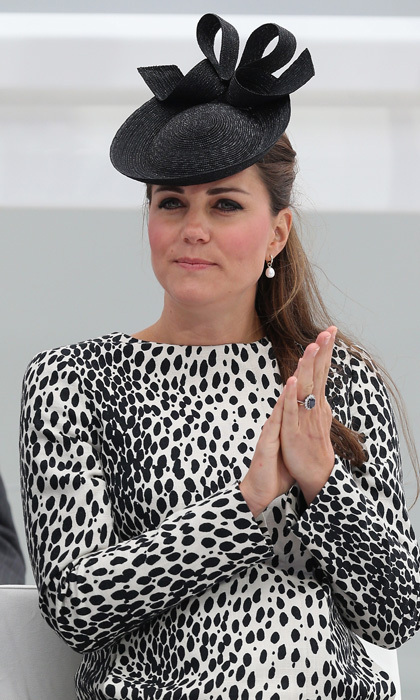 At eight months pregnant, Kate kept all the focus on her fashion-forward, Dalmatian-print dress, which she paired with a bow-detailed hat designed by none other than Jane Taylor.