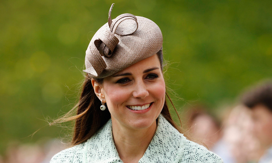 We spot a hat trick! Expectant Kate recycled her favourite straw-coloured headpiece to attend the National Review of Queen's Scouts in 2013.