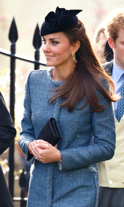 The practical royal recycled her blue M. Missoni coat for a friends' wedding in 2014, but she jazzed up the look with a navy-blue chapeau and a matching clutch.