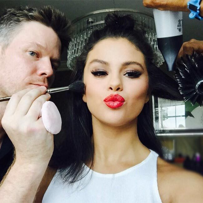 "Selena looked every inch a beauty icon when she shared a snap of herself getting her make-up done - but the star admitted she doesn't always manage to sit still! ""It's all fun until I move around too much and @byjakebailey gets mad at me,"" she joked in the caption.