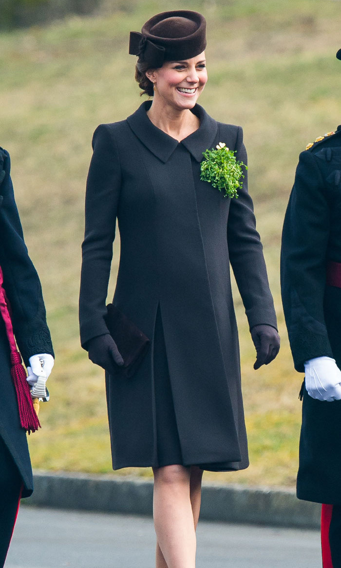 <p>Kate showed off her baby bump in this more muted green coat for the 2015 St. Patrick's Day parade. The brown hat complemented the green perfectly.</p>