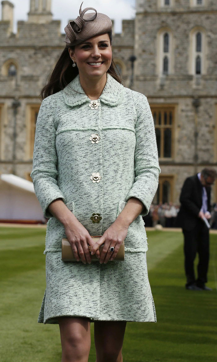 <p>Kate looks radiant while pregnant with Prince George in this Peter Pan collar coat with flower-shaped buttons at Windsor Castle.</p>