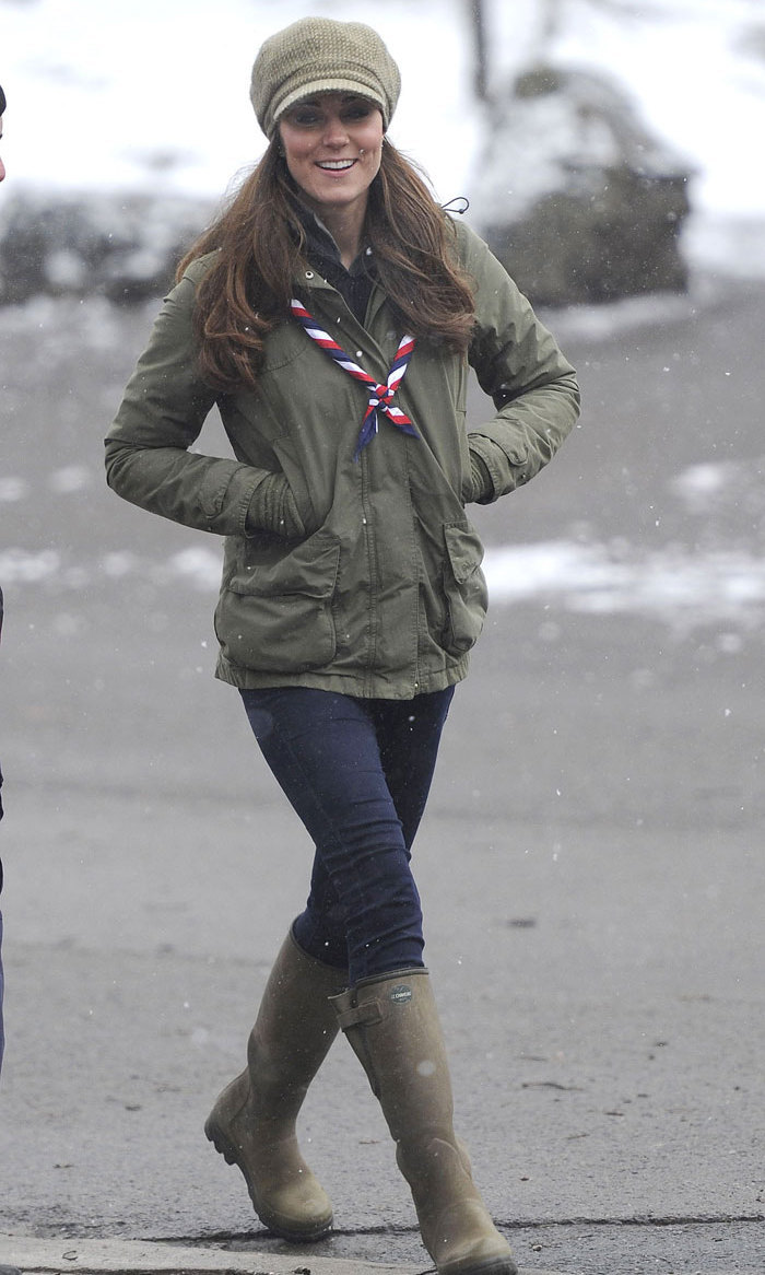<p>We rarely see Kate dressed down, so this was a treat! The royal looked very put together in matching cap, jacket and rain boots in 2013. The colorful scarf was worn to represent the scouts on a visit to the Great Tower Scout Camp in England's Lake District.</p>