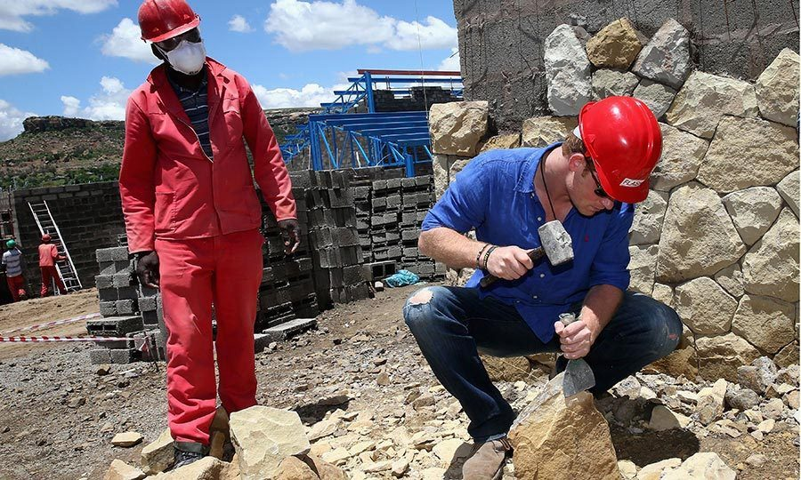 <p>Never afraid to get his hands dirty, in 2014 the Prince helped break down some sandstone at the construction site for a new Sentebale children's center in Maseru, Lesotho.