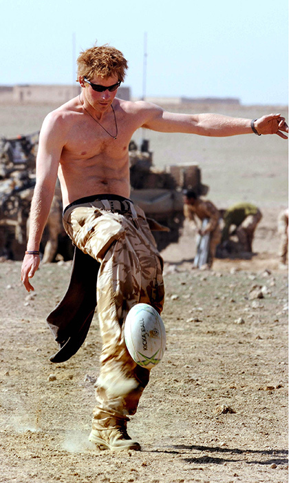 <p>Sports fan Harry took some time out for rugby practice in the desert in Helmand Province while serving with the Army in Afghanistan in 2008.