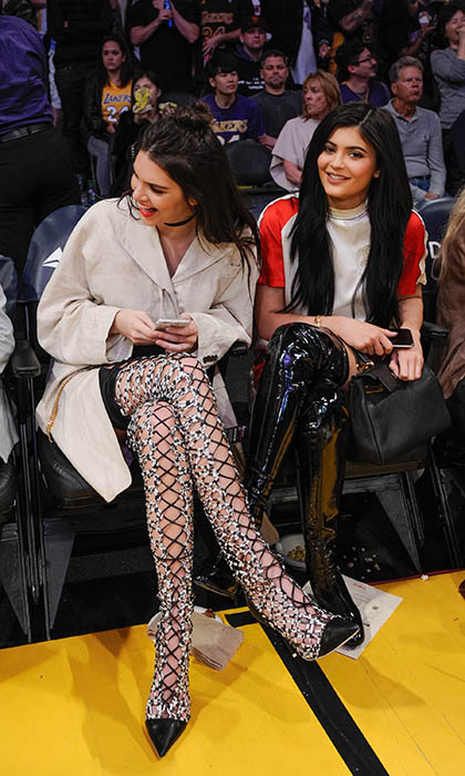 No doubt a-boot it, Kendall and Kylie Jenner's court side fashion is on point. The stylish sisters rocked knee-high boots to watch the L.A. Lakers take on the Sacramento Kings on Mar. 15. 