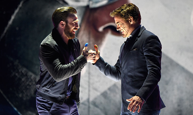 <i>Avengers</i> and good friends Chris Evans and Robert Downey Jr. faced off in an epic thumb wrestle on stage at the Kids' Choice Awards in L.A.