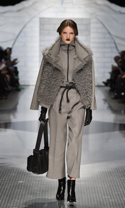 When she's not topping best-dressed lists in bold-hued ensembles, grey is one of Sophie's go-to hues. This multi-textured Mackage offering pairs slouchy, short pants and a turtleneck with a furry, high-fashion jacket and leather details.