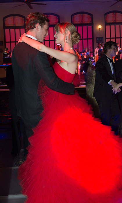 For the special occasion, Pierre Casiraghi's wife wore an extravagant bright red strapless Giambattista Valli ball gown.