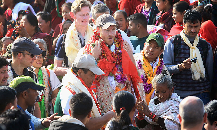 Prince Harry arrives into the Himalayan village of Okhari on day four of his trip to Nepal