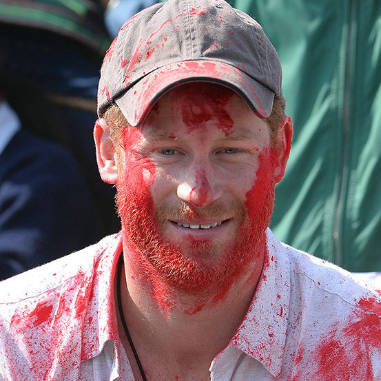Prince Harry was covered in red paint during the celebration of Holi.