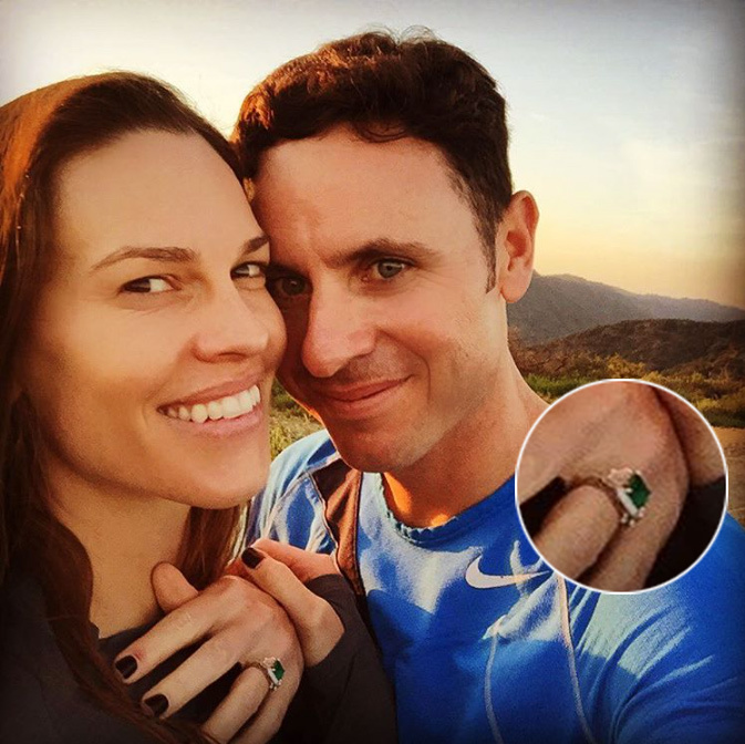 Hilary Swank was over the moon after her tennis coach boyfriend, Ruben Torres, popped the question while on a hike. The actress shared a series of photos on Instagram, including this one, which shows off her striking, retro-inspired ring - a huge emerald stone wrapped in a halo of diamonds.