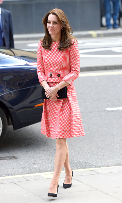 "Kate showed off her tiny silhouette in this retro chic red-and-white checkered Eponine London dress, calling to mind Jackie O as she arrived at the XLP project at London Wall. The small brand saw so much interest after the stylish royal's outing that their site crashed. The ""Kate Effect"" strikes again! 