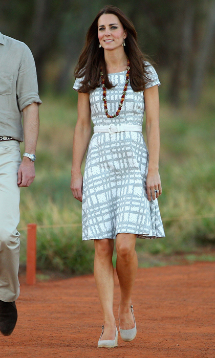 Once again, Kate stunned in a Hobbs spring dress as she strolled with Prince William down Kuniya Walk at the base of Uluru in Ayers Rock, Australia in 2014. She topped it off with a traditional Aboriginal necklace gifted to her upon arrival to the region. 
