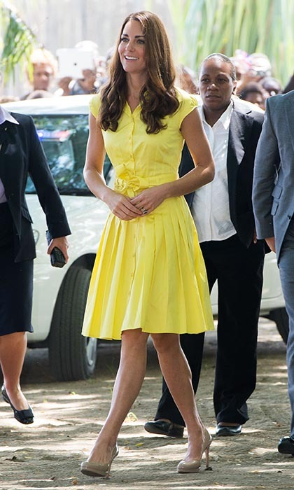 Looking like a true ray of sunshine, Kate was radiant in a primrose-yellow sleeveless dress from high street store Jaeger. This pleated shirt-dress was the perfect choice for Kate as she and Prince William popped by a cultural village in Honiara, Guadalcanal Island, on the couple's Diamond Jubilee tour in 2012. Kate paired the yellow dress with her nude L.K. Bennett Sledge pumps. 