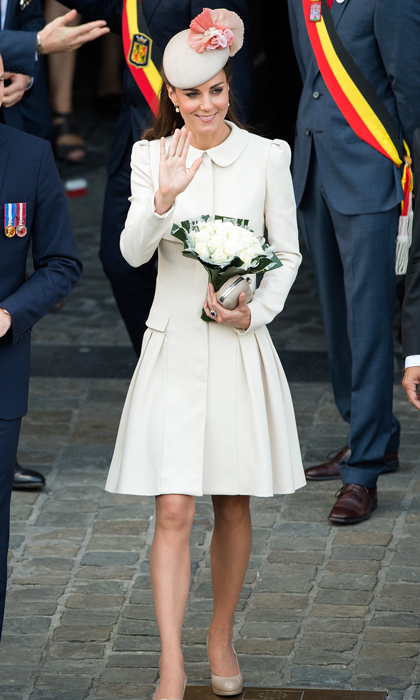 Attending a special ceremony and reception at the Grand Place in Mons, Germany, Kate proved her sartorial prowess in a stunning cream coat dress with a pleated skirt by Alexander McQueen. She topped her neutral look off with a matching Jane Taylor hat featuring dusty-pink roses and, of course, her L.K. Bennett heels. 