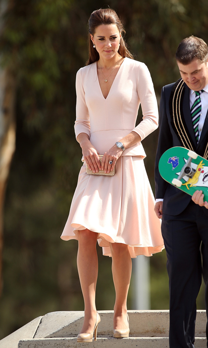 Looking pretty in pink in an Alexander McQueen dress with a risqué low-v neckline and her trusty L.K. Bennett heels, Kate demonstrated the value of simplicity in 2014 while on a tour of a skate park in Australia. 