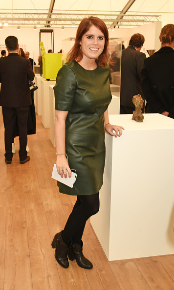Stylish in a green leather mini at a Frieze Art Fair preview in 2015.