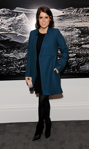 She added a pop of color to her black ensemble with a blue coat at a private viewing of 'Monuments' by Fabien Baron.