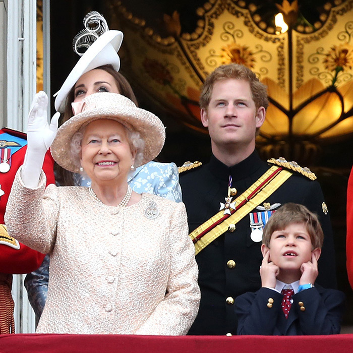 It's loud, Granny! Queen Elizabeth waves as young grandson Viscount Severn plugs his ears during the annual Trooping The Colour ceremony on June 13, 2015 in London, England.