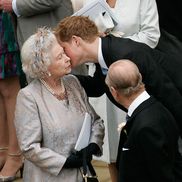 Prince Harry kisses his grandmother at his cousin Peter Phillips's wedding at St George's Chapel in Windsor Castle on May 17, 2008.