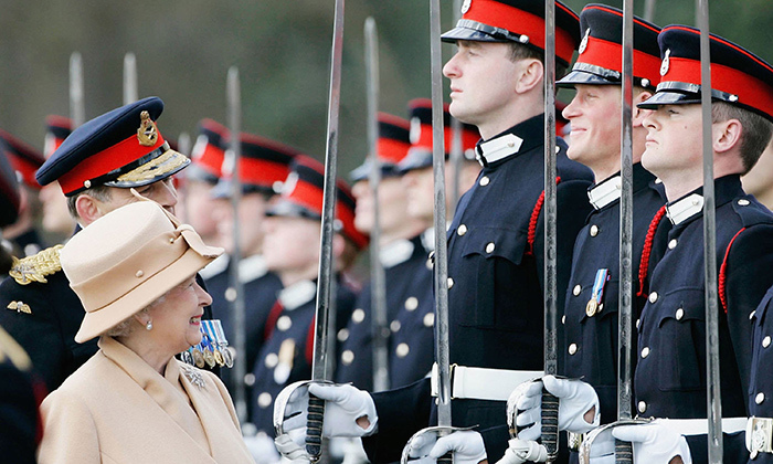 Prince Harry, second from right, famously broke out into laughter when his grandmother passed during an official inspection at his military academy, Sandhurst.