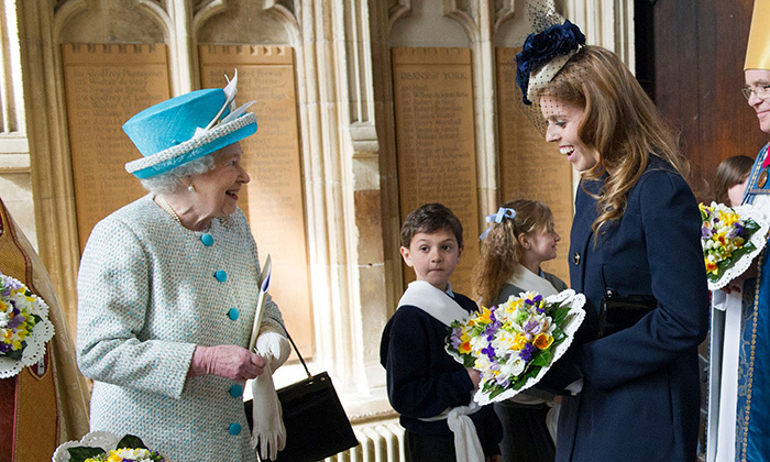 Queen Elizabeth with Princess Beatrice at a Maundy Thursday Service at York Minster on April 5, 2012 in York, England.