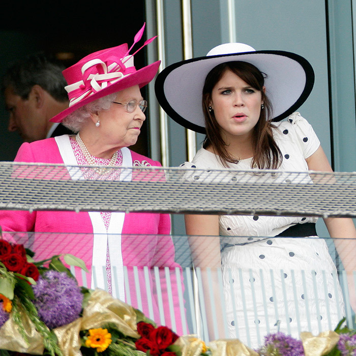 Hats off to grandmothers! Queen Elizabeth and Princess Eugenie hit Epsom racecourse in England back in 2011.